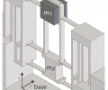 The CAD model shows the mechanical flexure design.