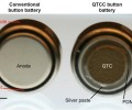 FIG 2. At left, a typical button battery; at right, a button battery coated with quantum tunneling composite (QTC).  Image: Bryan Laulicht