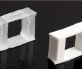 Two three-block filters with the same dimensions are pictured. The filter on the left is printed with pure SIS polymer. The filter on the right contains 26% Al2O3.