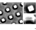 FIG. 4 are SEM images of silica particles self-assembled on a micro-scale structured surface.