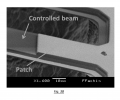 FIG. 3B is an image of a scanning electron microscopy showing a MEMS structure with a patch covering a portion of a controlled beam