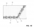 FIG. 1E illustrates a photonic crystal layer suitable for use in a photonic crystal laser for coupling light out of a defect layer according to embodiments of the present invention.